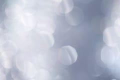 Shiny Silver Background Texture. Dynamic, shiny silver glitter bokeh background texture royalty free stock photos