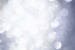 Shiny Silver Background Texture. Silver glitter bokeh with bright light flare Stock Image