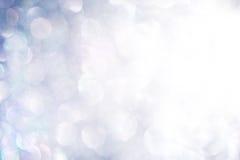 Shiny Silver Background Texture. Silver glitter bokeh with bright light flare in corner stock photo