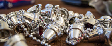 Shiny silver Christmas decoration on a brown surface. Close up Stock Photography