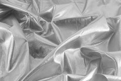 Shiny silver fabric. Closeup of shiney silver fabric for making special occasion garments Royalty Free Stock Photo