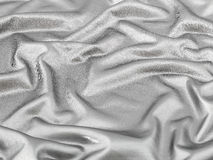 Shiny silver fabric background Stock Image