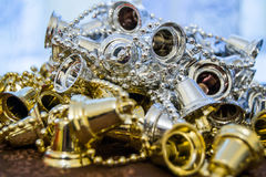 Shiny silver and golden Christmas decoration on a brown surface Royalty Free Stock Photo