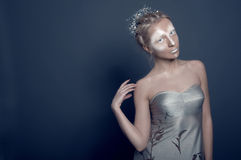 Shiny silver lady in silver dress Royalty Free Stock Photo