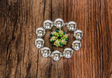 shiny silver metallic bracelet with beautiful small broach in the middle isolated on old vintage hardwood Stock Photography