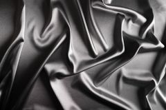 Shiny silver satin Stock Images