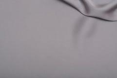Shiny silver satin silk fabric background Stock Photos