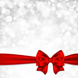 Shiny silver starry christmas background with red bow.  Stock Photos