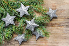 Shiny silver stars on fir branch Royalty Free Stock Photo