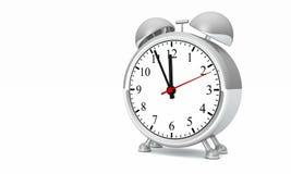 Shiny Silver Vintage Alarm Clock. Silver metal old fashioned vintage alarm clock with hands near twelve o'clock Stock Photos