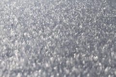 Shiny snow crystals. Close up of shiny snow crystals on field royalty free stock photo
