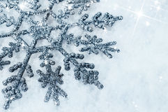 Shiny snowflake in the snow close-up Royalty Free Stock Photos