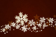 Shiny snowflakes on dark red background Royalty Free Stock Photo