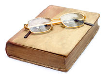 Shiny spectacles on an old book Royalty Free Stock Photography