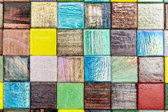Shiny square little glass multicolored smalt with light reflecti Royalty Free Stock Image