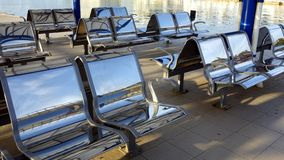 Shiny Stainless Steel Seats Stock Image