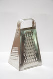 Shiny stainless steel cheese grater Stock Photography