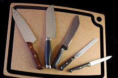 Shiny Stainless Steel Knives and Cutting Board Royalty Free Stock Photography