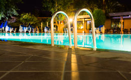 Shiny stainless steel pool entrance to outdoor pool in holiday r Stock Image