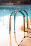 Shiny stainless steel pool entrance to outdoor pool in holiday r Stock Images