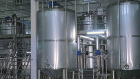 Shiny stainless steel storages, valves and pipes in a modern dairy. stock video footage