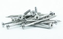 Shiny stainless steel wood screws on white background stock images