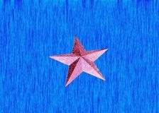 Shiny star at the blue background Stock Images