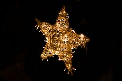 Shiny star made of electric garland as a Christmas decoration isolated on black. Background stock images