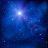 Shiny star on night sky Stock Image