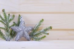 Shiny star ornament with fir branches Stock Photo