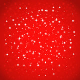 Shiny starry lights on red background. Stock Images