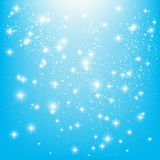 Shiny stars on blue Stock Images