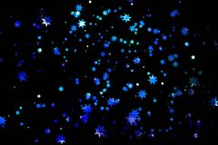Shiny stars on blue background Stock Images