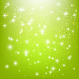 Shiny stars on green Royalty Free Stock Photos