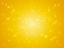 Shiny stars with light at centre abstract background in gold yellow colour. Stock Photo
