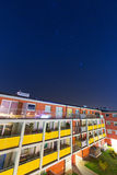 Shiny stars over apartment building Stock Images