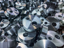 Shiny steel cylindrical parts background. Pile of many turning drilled parts with selective focus Stock Photography