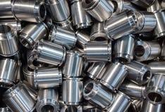 Shiny steel parts backround. Pile of many turning engineering parts Royalty Free Stock Photo