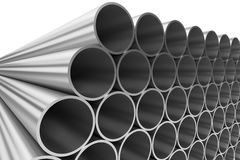Shiny steel pipes in rows isolated on white Royalty Free Stock Photo
