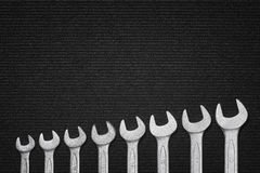 Shiny steel wrenches on a dark fabric background Stock Photography