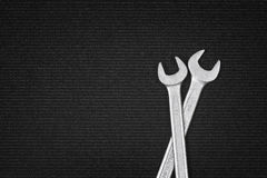 Shiny steel wrenches on a dark fabric background Royalty Free Stock Images