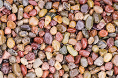 Shiny stones or pebbles for use as a background Royalty Free Stock Photography