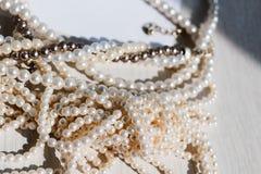 Shiny strands of pearls royalty free stock photos