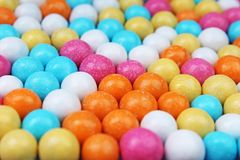 Shiny sugar coated round chocolate balls as background. Candy bonbons multicolored texture. Round candies sweets pattern. Concept. Food photo studio photography Stock Images