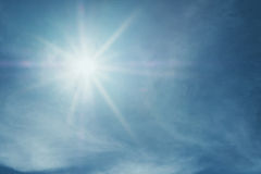 Shiny sun lens flare on blue sky Royalty Free Stock Photo