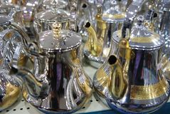 Shiny tea pots Arabian style coffee pods Gold and Silver stock photography
