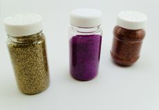 Shiny threesome galaxy. Three bottles of glitter  on a background white Royalty Free Stock Photo