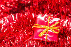 Shiny tinsel and little gift box Stock Photo