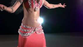Shiny torso of a beautiful young girl belly dancer stock video