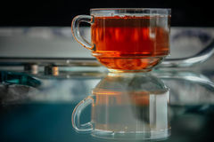 Shiny transparent glass cup with tea. Stock Photo